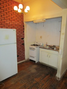 Will a gut renovation make the price worthwhile? Note the floor.