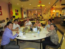 """Seven of us ate grandly and consumed bear in a Chinese restaurant.  That's """"my"""" family around the table."""