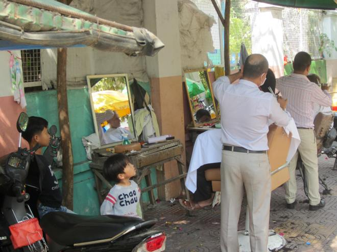 Shave and a haircut costs little more than two bits in Cambodia.