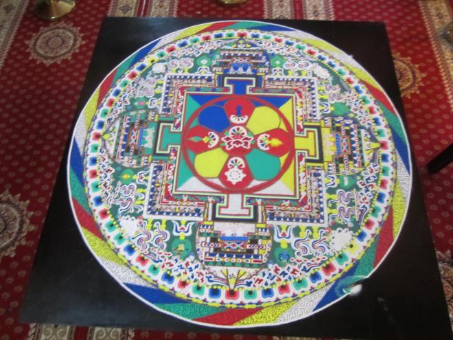Intricate sand mandala created in exquisite detail at the even.  It is described as, a cosmic diagram that represents the dwelling place of a deity.