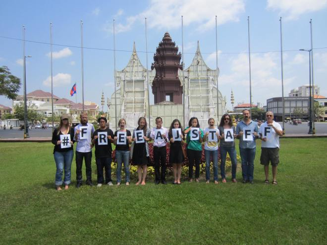 "That's me holding the last ""F"" and Rick Valenzuela of the Phnom Penh Post and Overseas Press Club holding the ""R,"" third from right."