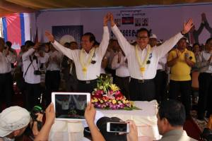 Kem Sokha (left) and Sam Rainsy at Sunday's event.