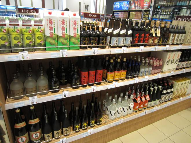 In one supermarket, the selection of alcohol imported from Japan warms the display of local products at the end of the shelfs.