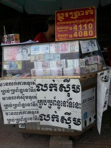 Currency exchanges exist inside local markets and, like this one, across the street from mine.