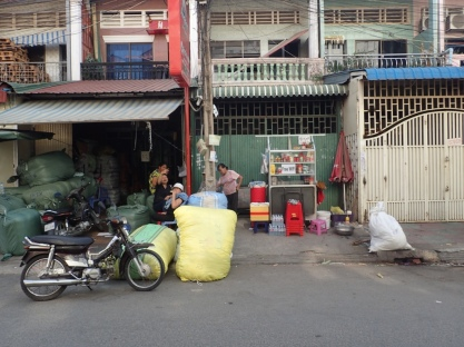 Although this shop, shown in both photos, is about as modest as it comes, it provides a lure to consumers.