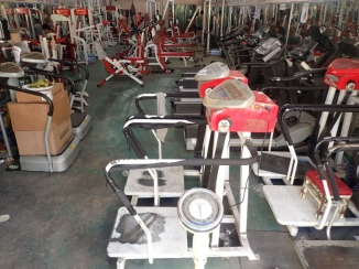 Air conditioning is absent at this basic gym, which features tired equipment and close quarters as opposed to mine below.