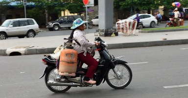 Transporting propane-gas tanks, this woman probably is doing her job.